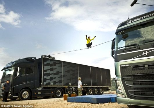 Walking A Slackline Between Two Running Trucks